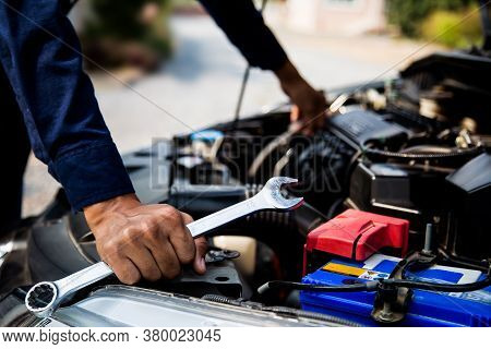 Close-up Hand Of Auto Mechanic Using Wrench To Repair A Car Engine. Concepts Of Car Care Fix Repair
