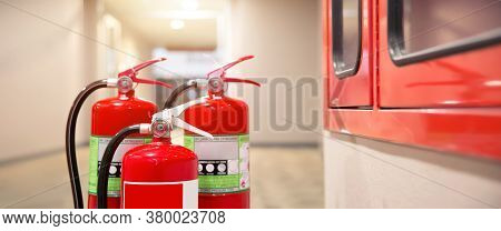 Close-up The Red Fire Extinguishers Tank At The Exit Door In The Building Concepts For Emergency Saf