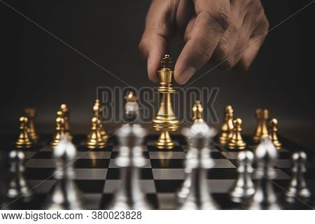 Close Up Hand Choose Gold Chess To Challenge With Silve Chess Team On Chess Board Concept Of Busines