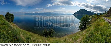 Panorama Of Shore Of Baikal Lake In Russia On A Summer Day Near Old Angasolka Village