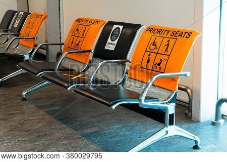 Empty Seats, Priority Seats In The Airport Gate Waiting Area. Social Distance, Stickers Asking Not T