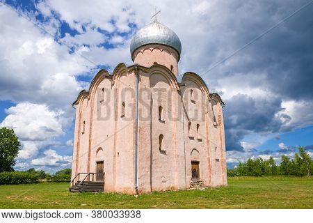 The Ancient Church Of The Savior On Nereditsa Close-up Under A Cloudy Sky. Surroundings Of Veliky No