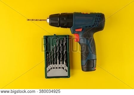 Cordless Drill, Screwdriver With Drill Bit On Yellow Background,top View