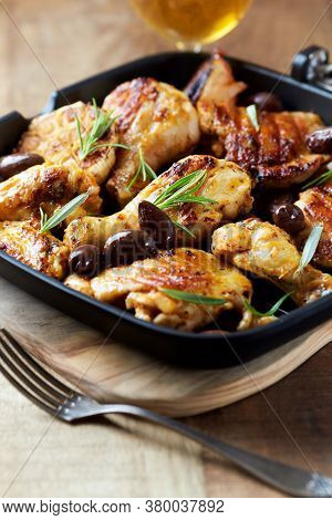 Grilled Chicken Pieces With Kalamata Olives And Fresh Rosemary. Rustic Wooden Background.