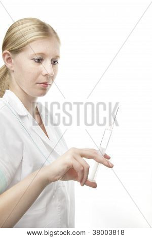 Beautiful Nurse With Syringe