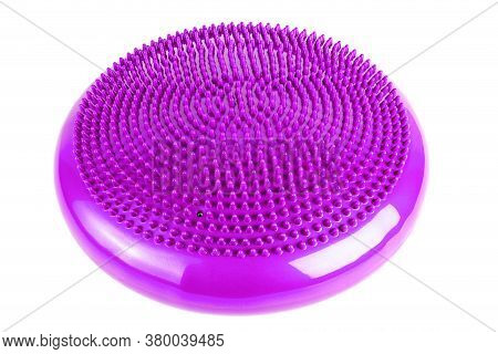 Purple Inflatable Balance Disk Isoleated On White Background, It Is Also Known As A Stability Disc,