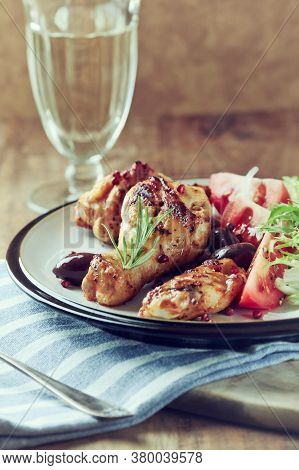 Grilled Chicken Pieces With Fresh Salad. Wooden Background.