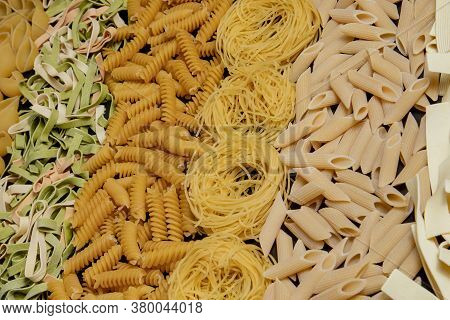 Variety Of Types And Shapes Of Dry Italian Pasta. Italian Macaroni Raw Food Background Or Texture:pa