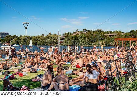 STOCKHOLM, SWEDEN - AUG 08, 2020: Sunbathers at Hornsbergsstrand