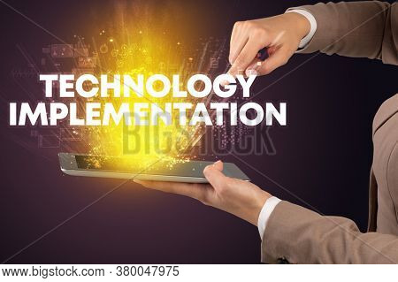 Close-up of a touchscreen with TECHNOLOGY IMPLEMENTATION inscription, innovative technology concept