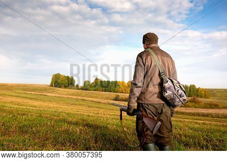 The Man Is On The Hunt. Autumn Hunting Season. Man Hunter With A Gun. Copy Space.
