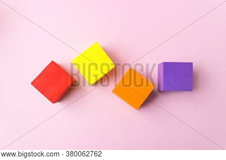 Colourful Blocks Smockup On Pink Background, Bricks Mockup, Copy Space. Empty Stack Of Cubes For Cre