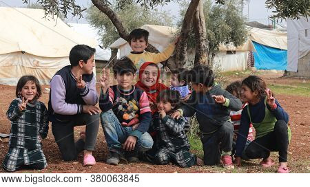 Aleppo, Syria, 10 December 2019\na Group Of Refugee Children Play Inside The Camp