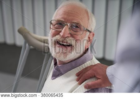 Elderly Patient Looking Thankful For His Doctors Care