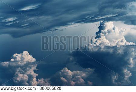 Dramatic stormy clouds as natural background, dangerous cumulonimbus clouds over dark blue sky.