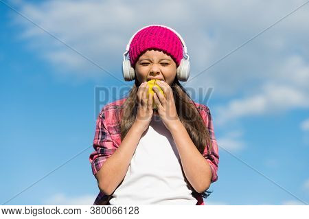 Healthy Food Choice. Little Kid Eat Apple On Sunny Blue Sky. Tooth-friendly Food. Dental Diet. Vitam