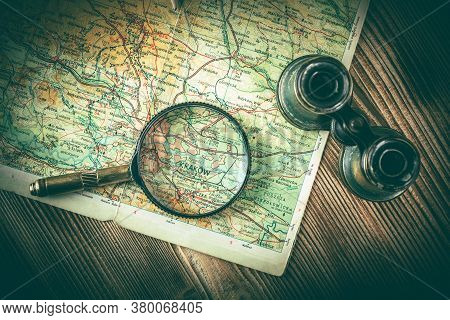 Magnifying Glass And Binoculars On The Old Map. Vintage Style. Selective Focus.