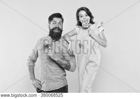 Sweet Time. Sweet Tooth Family Yellow Background. Happy Father And Daughter Hold Candies. Bearded Ma