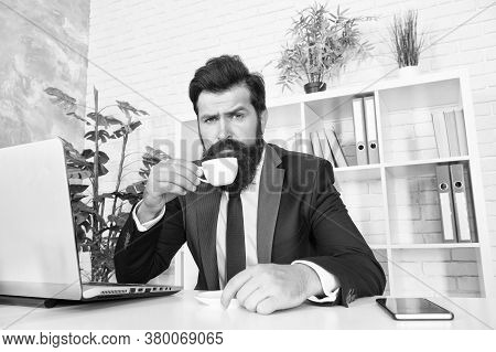 Comfy Workspace. Bearded Hipster Formal Suit Relaxing With Coffee. Office Life Is Unthinkable Withou