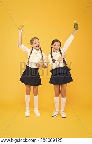 My Favourite Food. Happy Classmates In School Uniform. Back To School. Little Girls Hold Healthy Jui