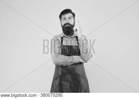 Hipster In Apron Thinking About Recipes. Easy To Cook Recipes. Unique Healthy Recipes. Plan Weekly M