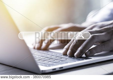 Searching Browsing Data Information Network Concept. Businessman Using Laptop Computer To Input Keyw