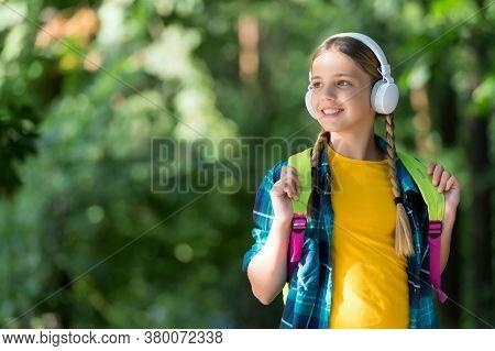 Bringing Joy Through Sound. Little Kid Listen To Music Natural Outdoors. Hi-fi Stereo Sound. New Tec