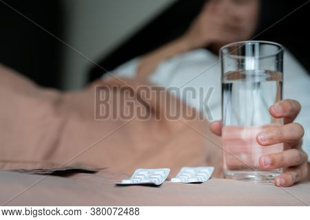 Medicine With Sick Women Hand Hold A Glass Of Water, Healthcare And Medicine Recovery Concept - Soft