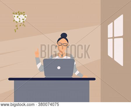 Adorable Woman Tutor Work On Laptop In Apartment.remote Work, Distance Learning Or Online Training D