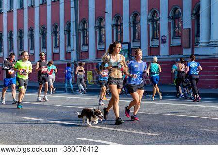St. Petersburg, Russia - August 09,  2020: Half Marathon Northern Capital. Tanned Slender Athletic G