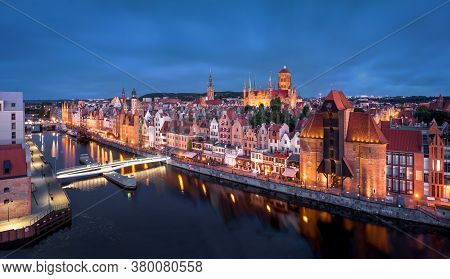Gdansk, Poland. Panoramic Aerial View Of Motlawa River Embankment In Old Town At Dusk