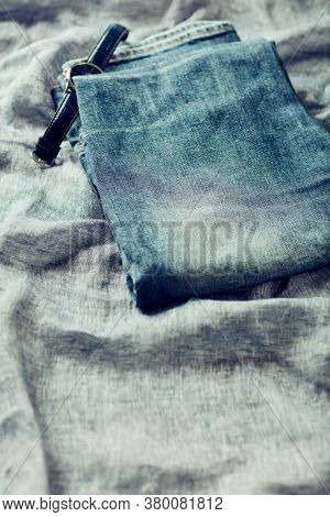 Jeans Trousers On Linen Background. Copy Space.