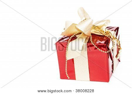 beautiful red christmas present with golden ribbons