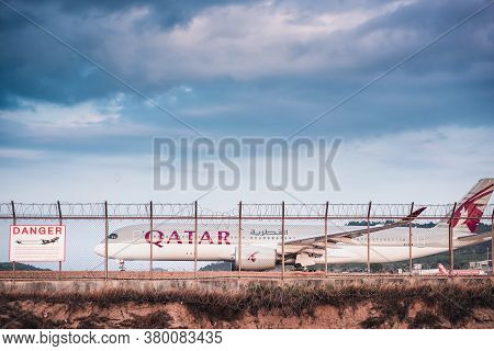 Phuket, Thailand - Feb 20, 2020: Qatar Airways Boeing 777 Airplane On Runway Track Preparation For T