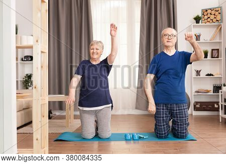 Happy Old Wife Exercising Near Her Husband. Old Person Healthy Lifestyle Exercise At Home, Workout A