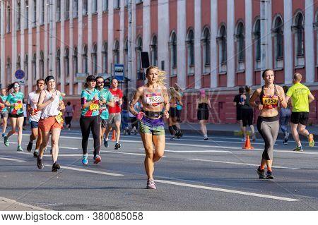St. Petersburg, Russia - August 09,  2020: Half Marathon Northern Capital. Tanned Slender Athletic W
