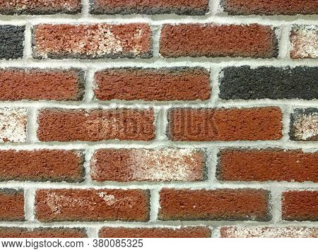 Detailed Close-up View Old Textured Red Black Brick Wall, Rich Colors And Shadows Suitable For Websi