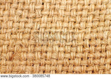 Brown Burlap Background. Macro Of Natural Rag Cloth Texture. Selective Focus