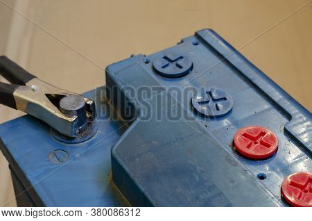 Negative Car Battery Terminal With Clip. The Process Of Charging A 12 Volt Battery. Old Battery With