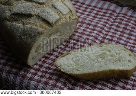 Freshly Baked Homemade Bread On A Red And White Towel.
