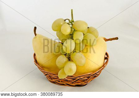 Fresh Ripe Healthy Yellow Pears And White Grapes In Basket, Ready To Eat, Sofia, Bulgaria