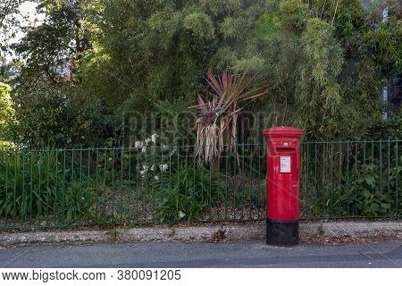 Red Letter Box Outside Public Park In Penzance, Cornwall Uk
