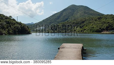 Mountain and sea with pier