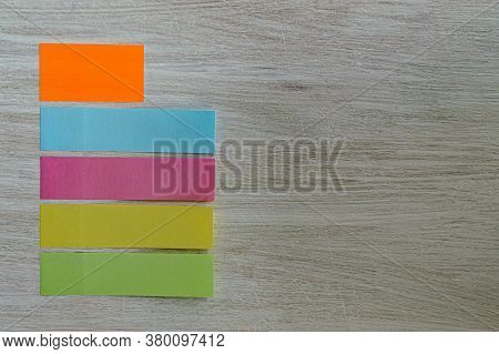 Stickers For Notes Bookmarks On A Textured Wooden Background Copy Space