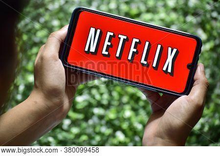 New Delhi, India - September 08, 2019: Women Use Netflix App On Smart Phone Screen. Netflix Is An In