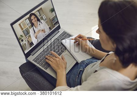 Online Medical Consultation. The Patient Consults With The Doctor Using The Video Conference Applica