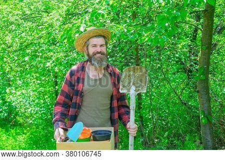 Professional Gardenergardener Work. Professional Gardener. Attractive Man Working In Garden. Happy B