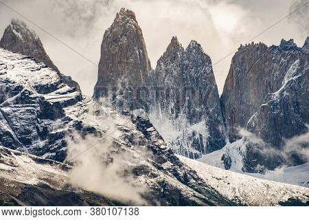 Torres del Paine peaks coming from clouds. Torres del Paine national park, Chile