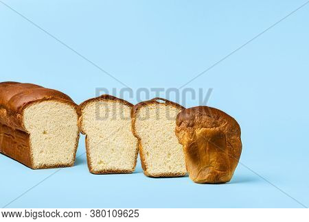 Sandwich Milk Bread, Sliced In Pieces, Isolated On Blue Background. Promotional Flyer For Hokkaido M