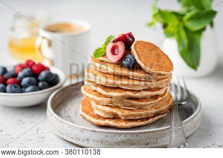 Healthy Oat Pancakes With Berries On A Craft Ceramic Plate. Vegan Breakfast Food